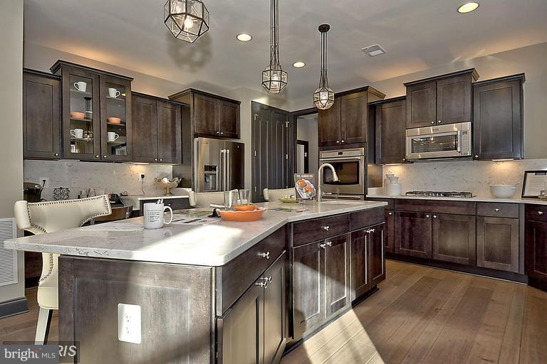 ISLAND DESIGNED FOR FOOD PREPPING AND CONVERSATION - 14270 BURNTWOODS RD, GLENWOOD