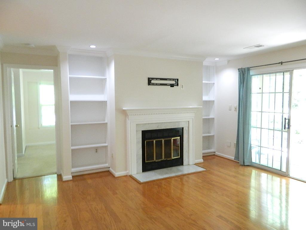 Fireplace and built-in bookcases - 2220 SPRINGWOOD DR #109B, RESTON