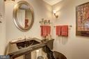 Powder room off of foyer - 5610 WISCONSIN AVE #1606, CHEVY CHASE