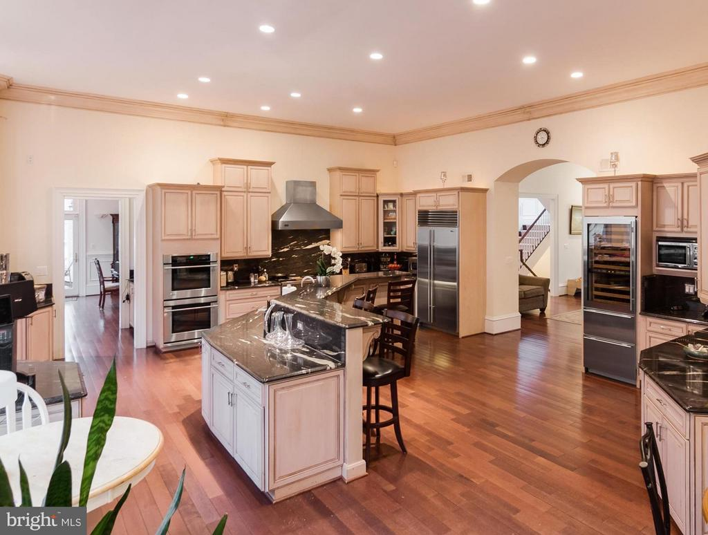 Gourmet Kitchen with flow for entertaining granite - 1347 KIRBY RD, MCLEAN