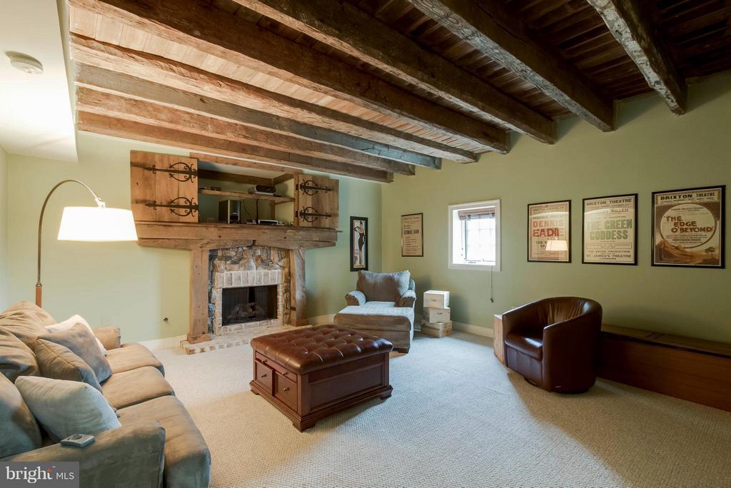 Basement media room w/hand hewn ceiling beams - 15826 OLD WATERFORD RD, PAEONIAN SPRINGS