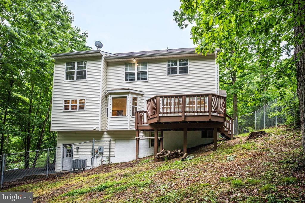 Large Deck and level walk out from garage. - 113 COLUMBUS CV, STAFFORD