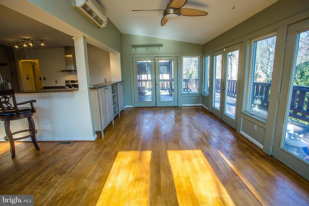 Kitchen has ample natural lighting leads, to porch - 7019 31ST ST NW, WASHINGTON