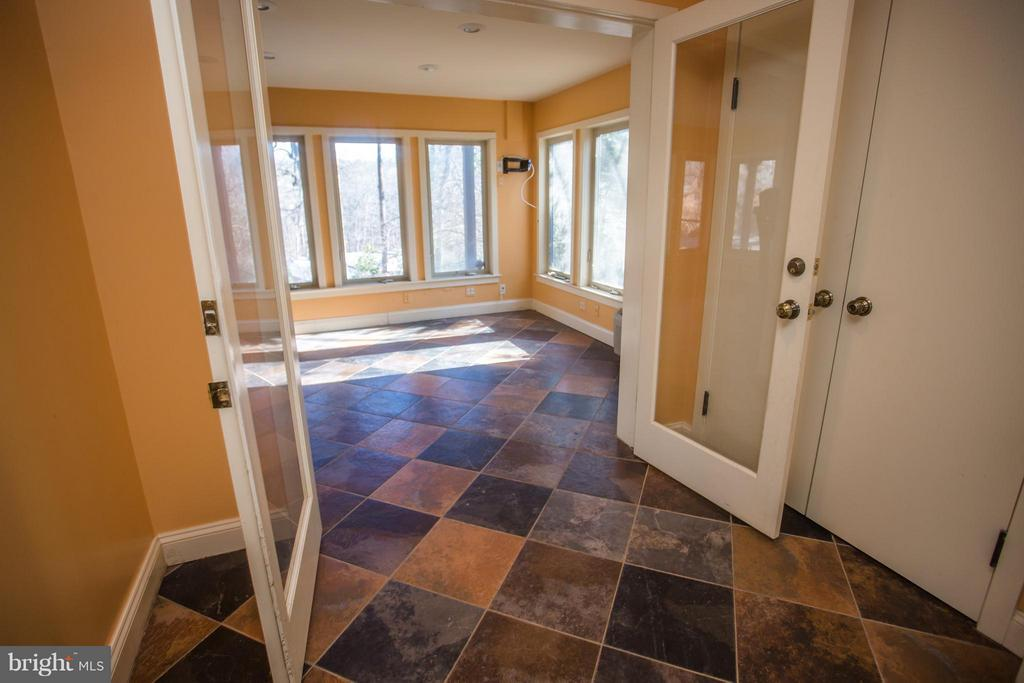 Tiles leads to exercise room and open backyard - 7019 31ST ST NW, WASHINGTON