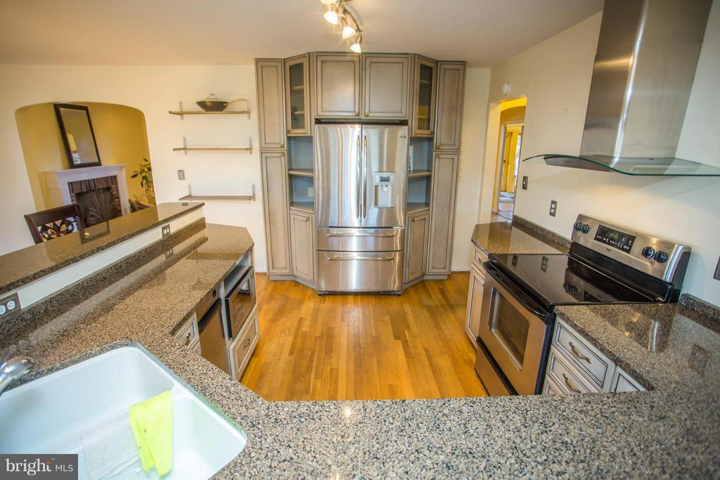 Range hood, granite countertops, and SS appliances - 7019 31ST ST NW, WASHINGTON