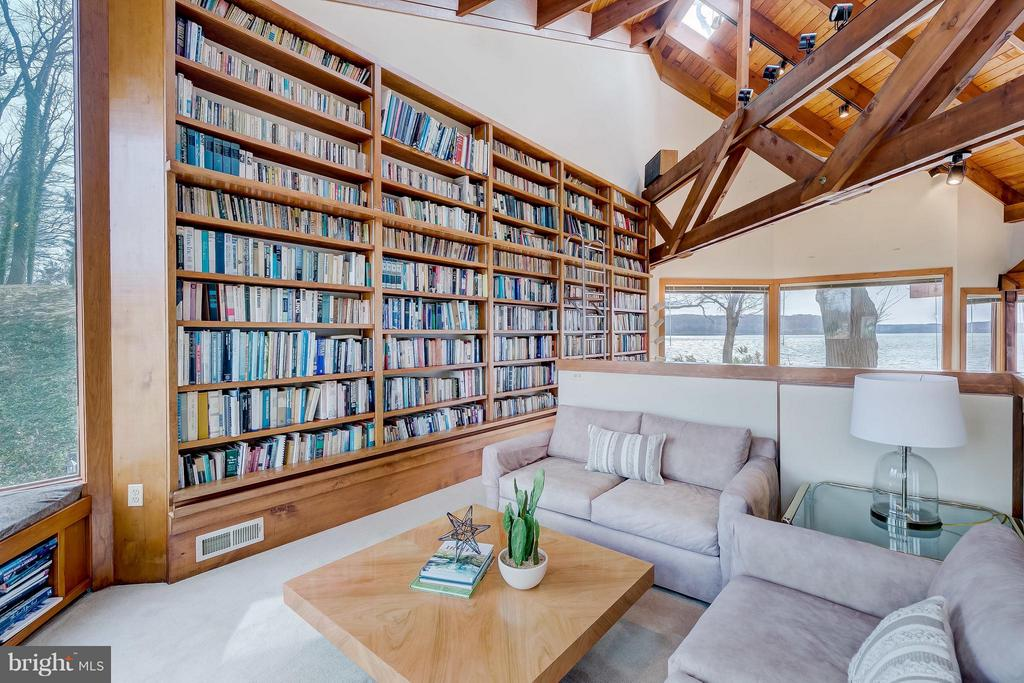 Reading nook in Great Room- amazing book shelves! - 312 RUGBY COVE RD, ARNOLD