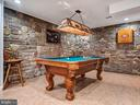 Play a game in the custom finished basement - 7621 STEWART HILL RD, ADAMSTOWN