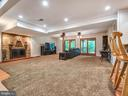 Built in fireplace, bar area and access to the dec - 7621 STEWART HILL RD, ADAMSTOWN