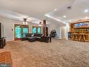 Fire place, bar, games, access to the back yard - 7621 STEWART HILL RD, ADAMSTOWN