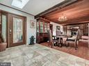 Open into a large dining room and living room - 7621 STEWART HILL RD, ADAMSTOWN