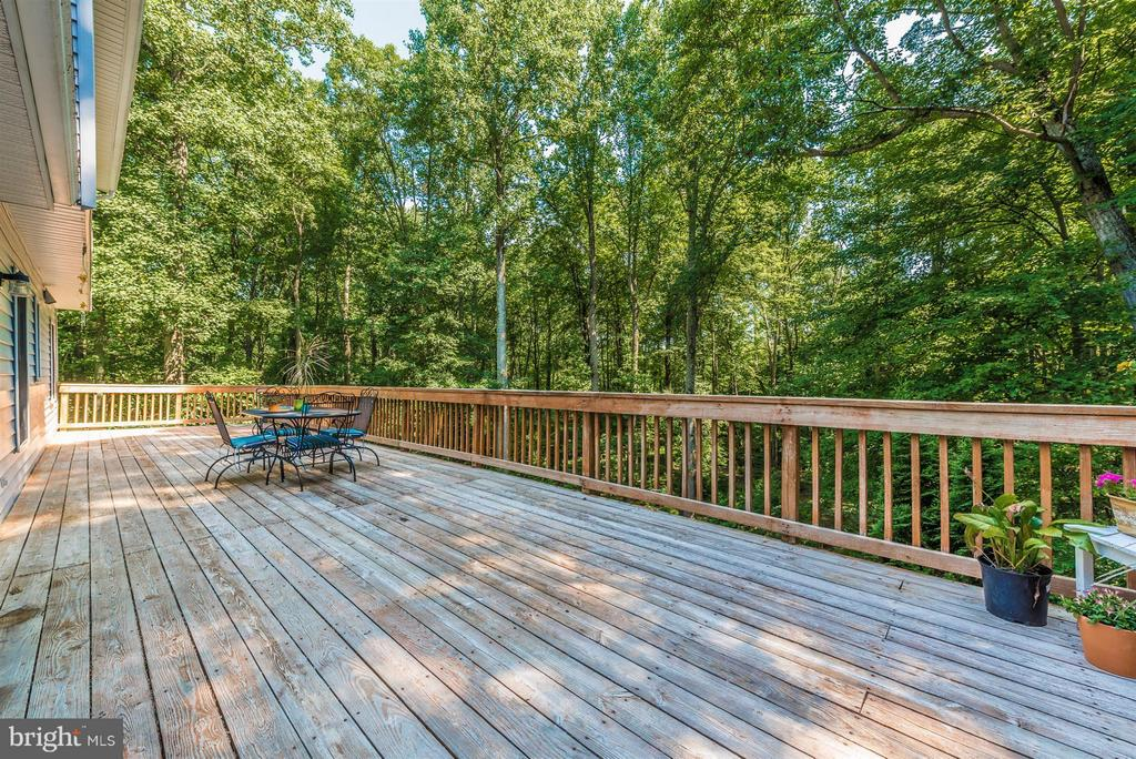 The deck is the entire width of the house - 4525 ROOP RD, MOUNT AIRY