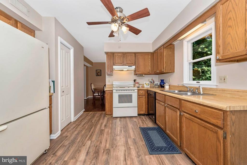 Galley kitchen opens up to family room - 4525 ROOP RD, MOUNT AIRY