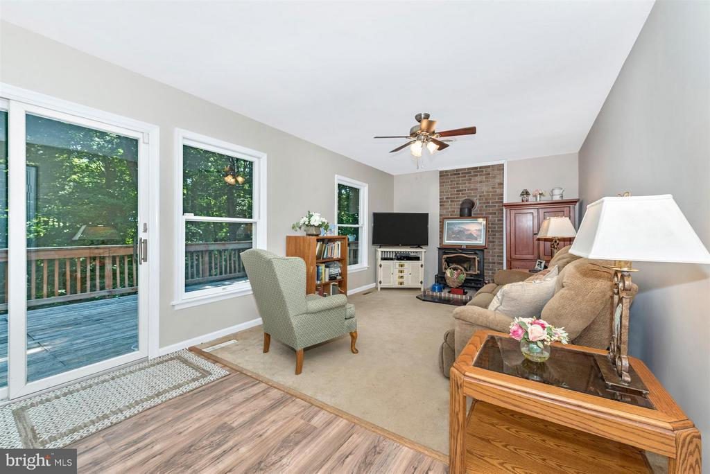 Family room opens up to huge deck - 4525 ROOP RD, MOUNT AIRY