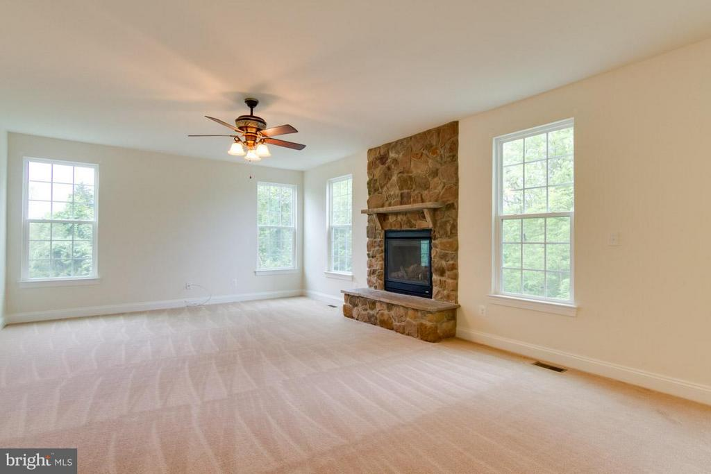 Family Room has Floor to Ceiling Stone Fireplace - 5 KETTLEBROOK CT, STAFFORD