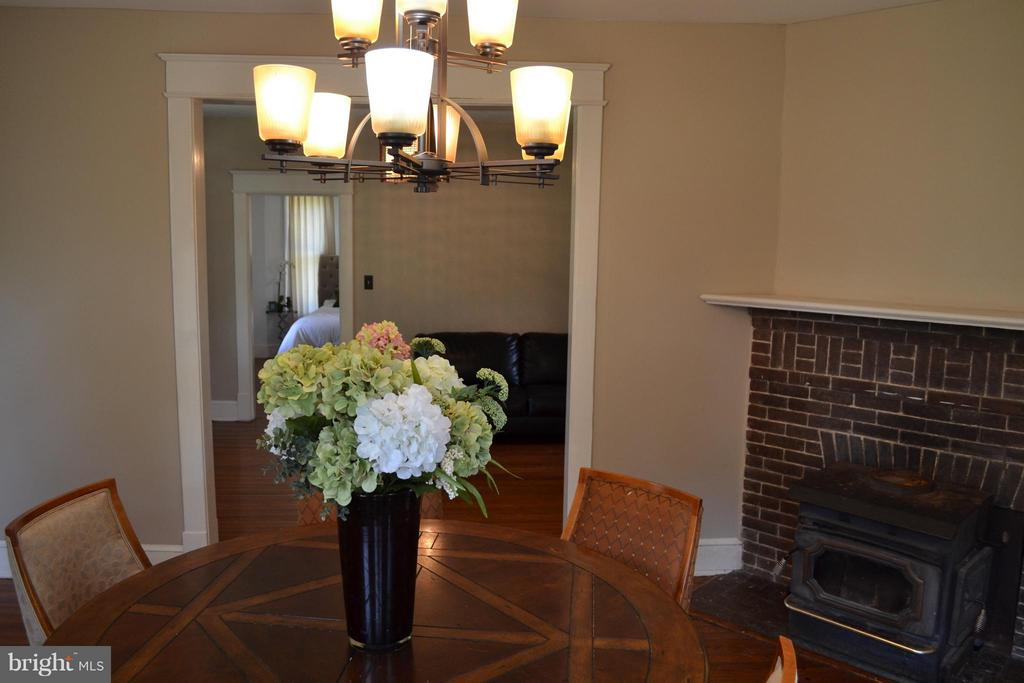 Dining Room with wood stove - 5707 MISTY DR, LANHAM