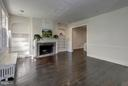 Living room with built-in book cases - 1533 FOXHALL RD NW, WASHINGTON