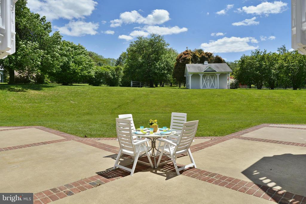 Brick Accented Patio overlooks Pastoral Views - 6901 CLIFTON RD, CLIFTON
