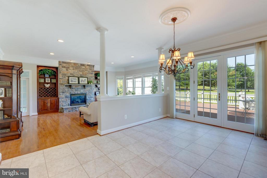 Large Open Kitchen with Access to Deck and Patio - 41605 SWIFTWATER DR, LEESBURG