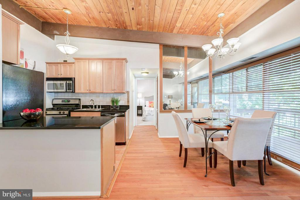 Living & dining flow into the kitchen - 7747 DONNYBROOK CT #206, ANNANDALE