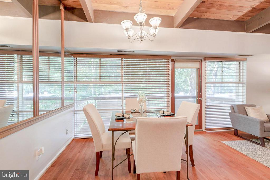 Dining room leads out to the balcony - 7747 DONNYBROOK CT #206, ANNANDALE