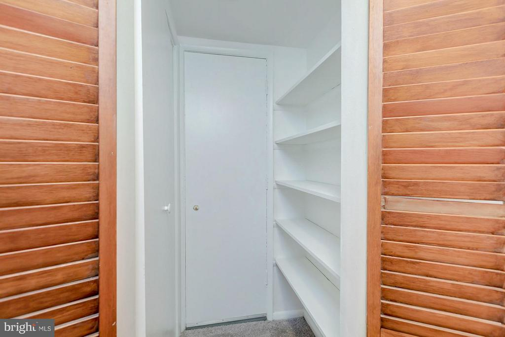 Linen closet/pantry in the hallways - 7747 DONNYBROOK CT #206, ANNANDALE