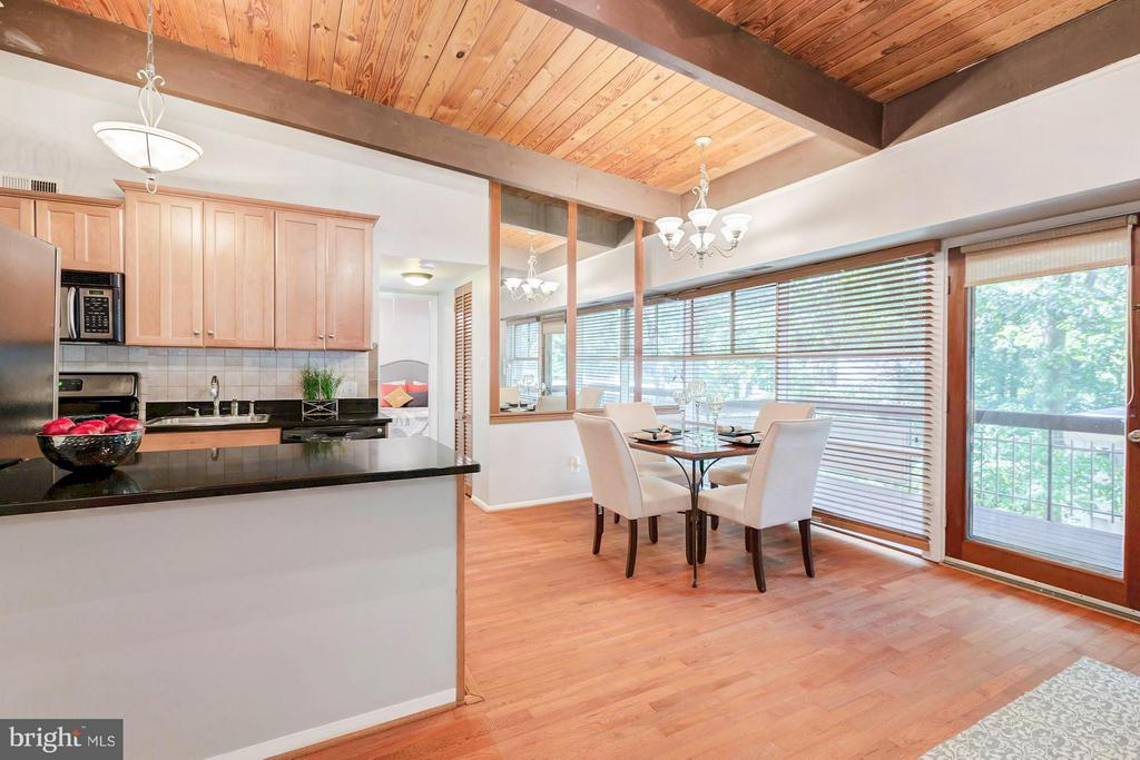 Kitchen overlooks the living space - 7747 DONNYBROOK CT #206, ANNANDALE