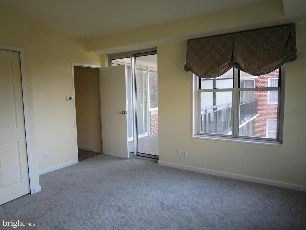 First Bedroom with Doors To Balcony - 3900 WATSON PL NW #A-5E, WASHINGTON
