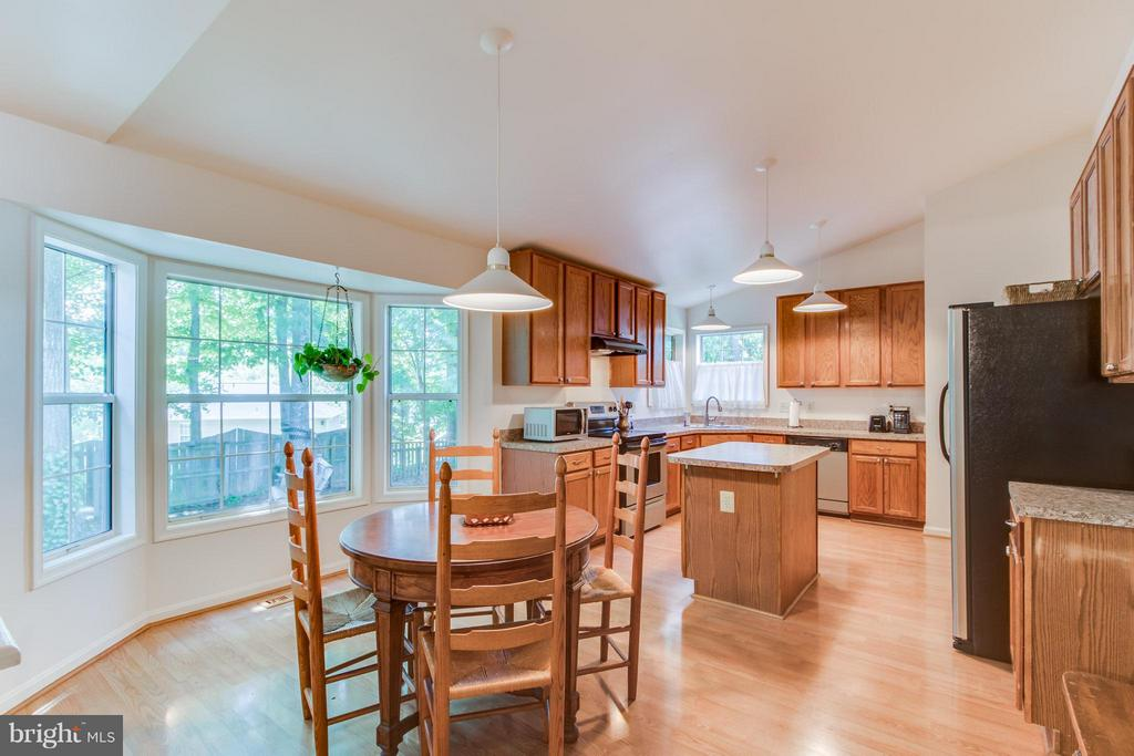 Kitchen with table space and bay window. - 16 JASON CT, STAFFORD