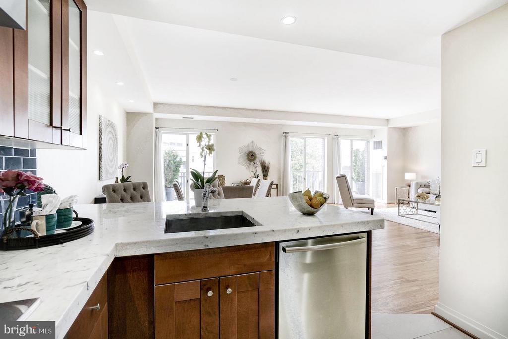Kitchen overlooks great room to large balcony - 3251 PROSPECT ST NW #412, WASHINGTON