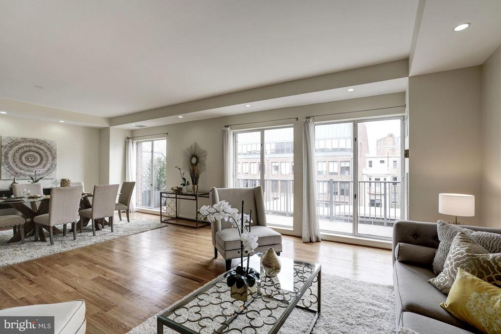 Spacious living room opens to large balcony - 3251 PROSPECT ST NW #412, WASHINGTON
