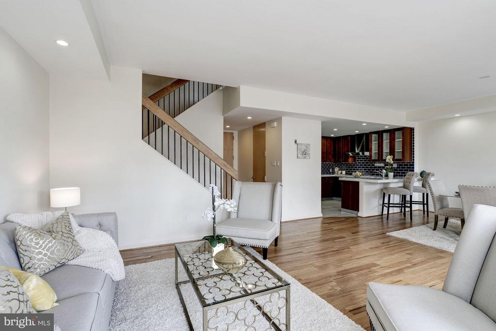 Spacious living room opens to dining area - 3251 PROSPECT ST NW #412, WASHINGTON