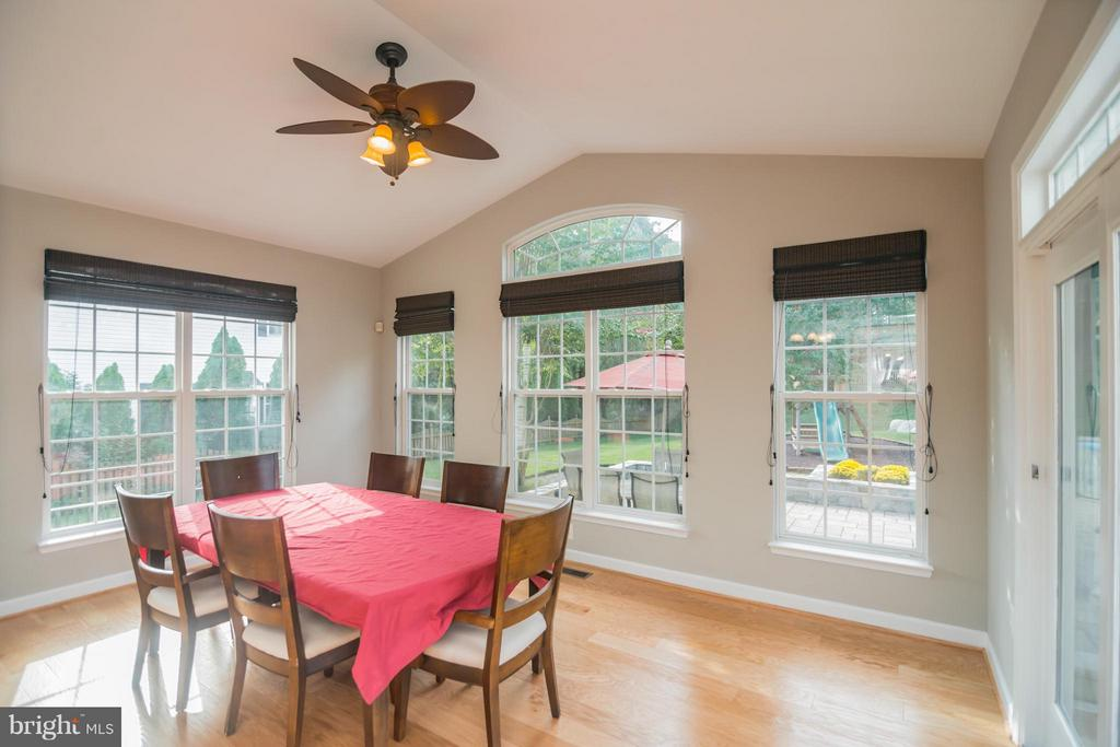 Sun drenched room over looking the backyard oasis - 25975 MCCOY CT, CHANTILLY