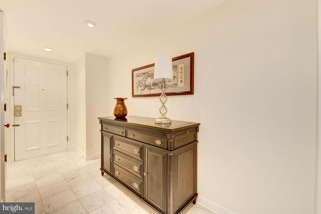 Foyer with coat closet and powder room - 2301 CONNECTICUT AVE NW #2C, WASHINGTON