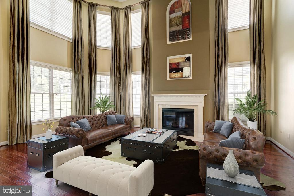 Two Story Family Room w Gas Fireplace - 11864 CHANCEFORD DR, WOODBRIDGE