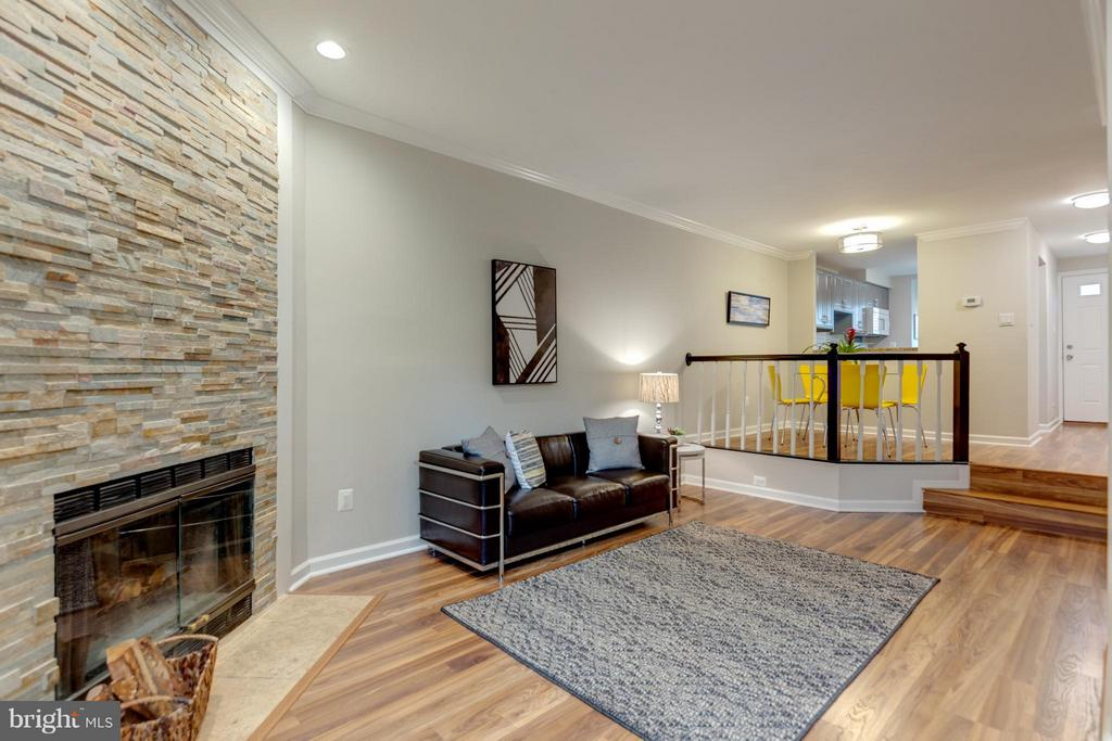 Don't miss the Stacked Stone Gas Fireplace! - 11189 SILENTWOOD LN, RESTON