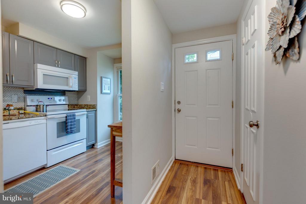 Entrance Hallway and 1./2 bath off Hall. - 11189 SILENTWOOD LN, RESTON