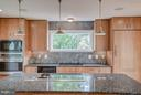 Kitchen with nature views and high-end appliances - 506 NORWOOD ST, ARLINGTON