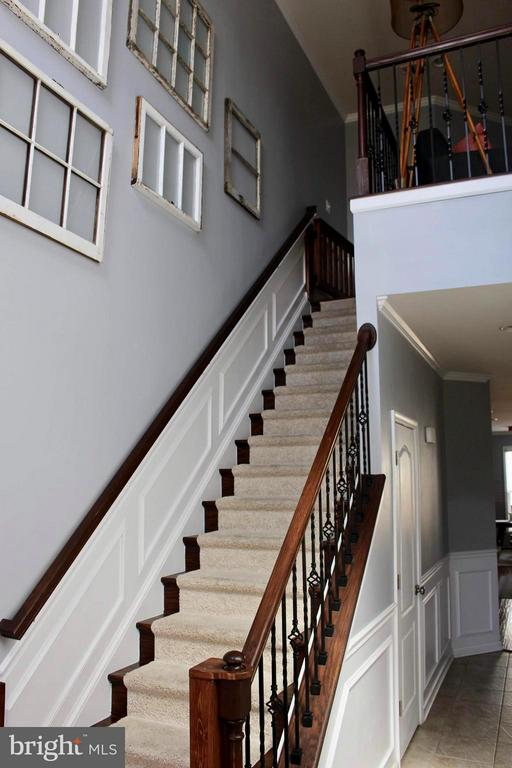 Wrought Iron spindles, custom trim and chair rail. - 41846 APATITE SQ, ALDIE