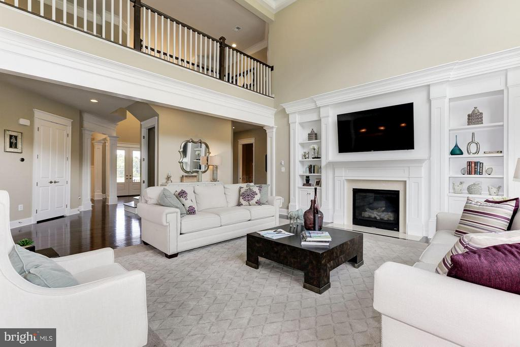Family Room with gas FP. Flatscreen conveys. - 40736 WILD PLUM DR, ALDIE