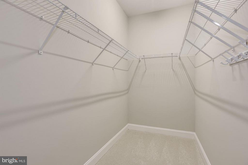 one of two walk-in closets in master bedroom - 1331 SUNDIAL DR, RESTON