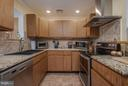 UPGRADED KITCHEN FEATURES GRANITE - 8021 RUGBY RD, MANASSAS PARK