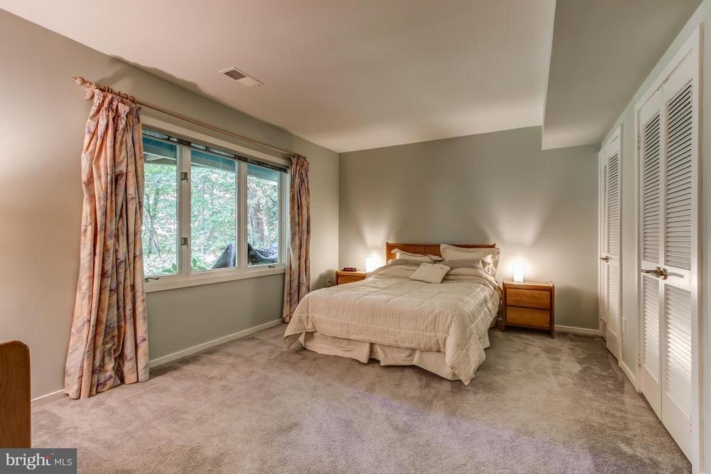 Lower Level Bedroom boasts large windows! - 1511 N VILLAGE RD, RESTON
