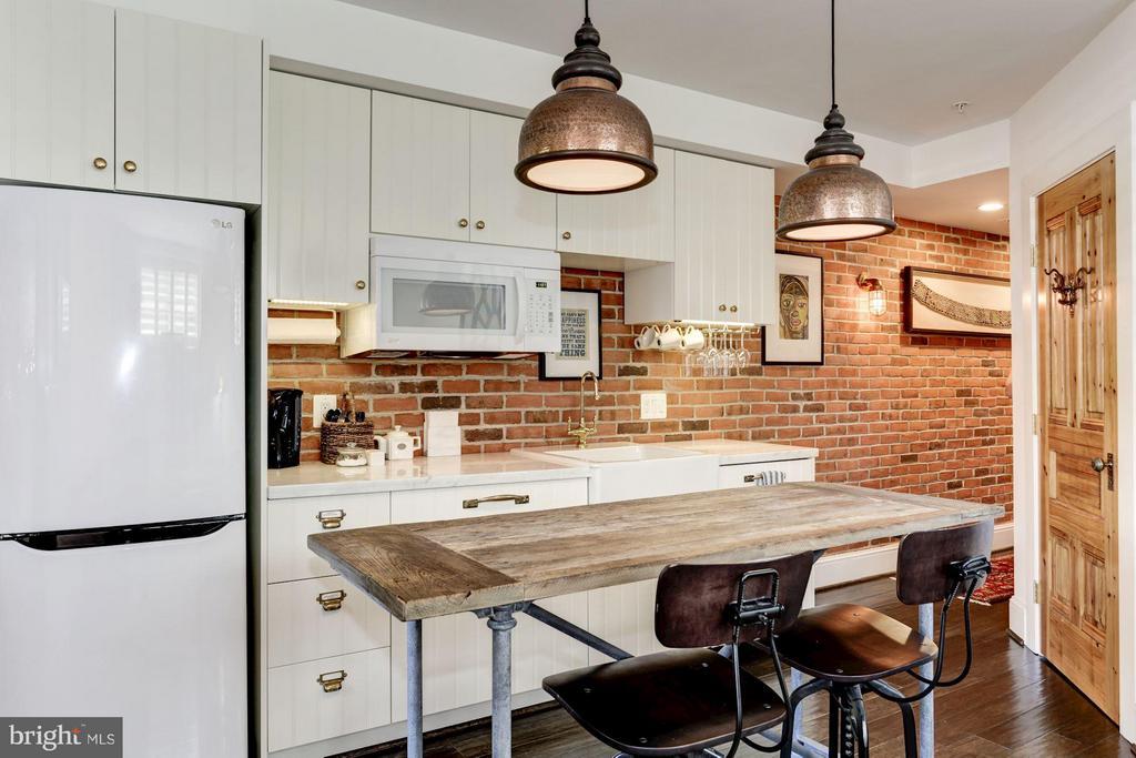 LL kitchen w/custom lightening, exposed brick - 1223 5TH ST NW, WASHINGTON