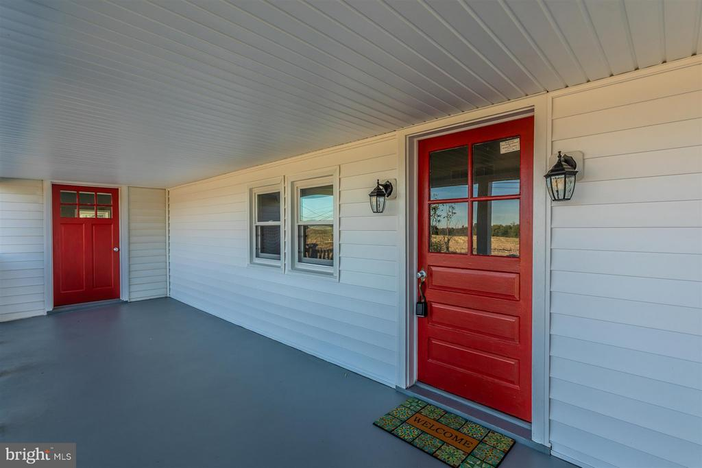 Large porch with two entries. - 10133 ROCKY RIDGE RD, ROCKY RIDGE