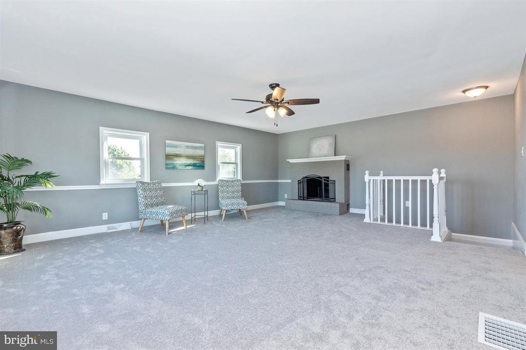 Large family room with wood burning fireplace. - 10133 ROCKY RIDGE RD, ROCKY RIDGE