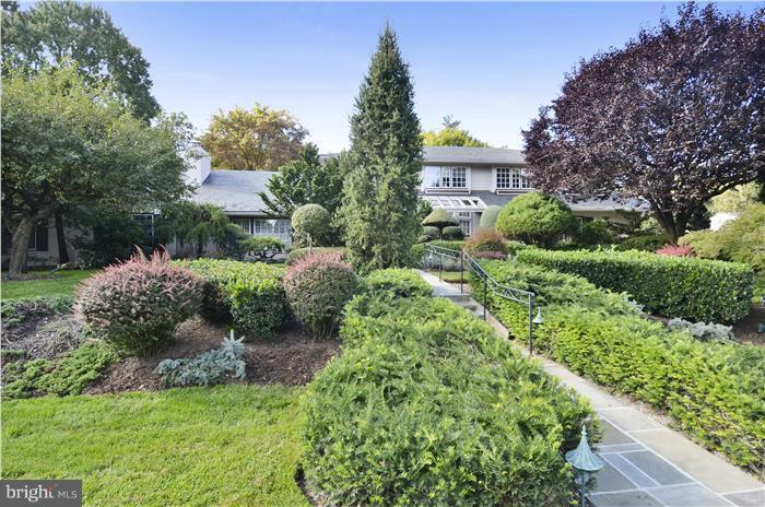 Front yard with extensive unique plants and shrubs - 11208 STEPHALEE LN, ROCKVILLE