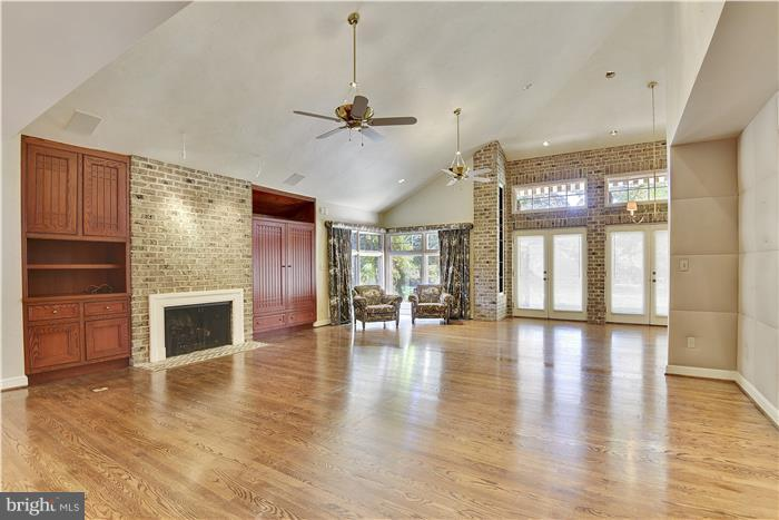 Family Room with gas fireplace and built-ins - 11208 STEPHALEE LN, ROCKVILLE
