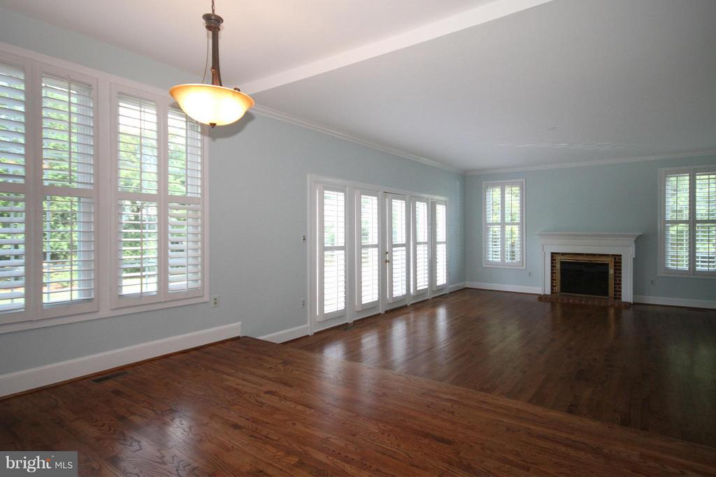 Sunken Family Room with brick fireplace - 1209 TOTTENHAM CT, RESTON