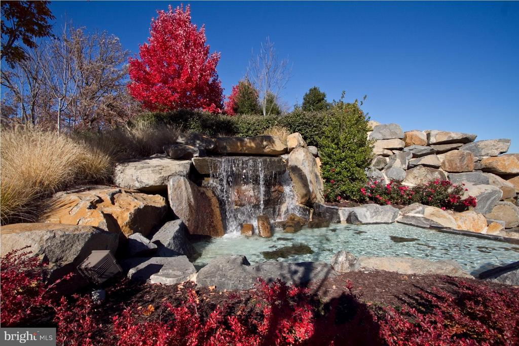 One of  the many waterfalls in the community. - 42730 EXPLORER DR, ASHBURN