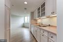 Kitchen w/ built-in cabinetry - 5600 WISCONSIN AVE #803, CHEVY CHASE